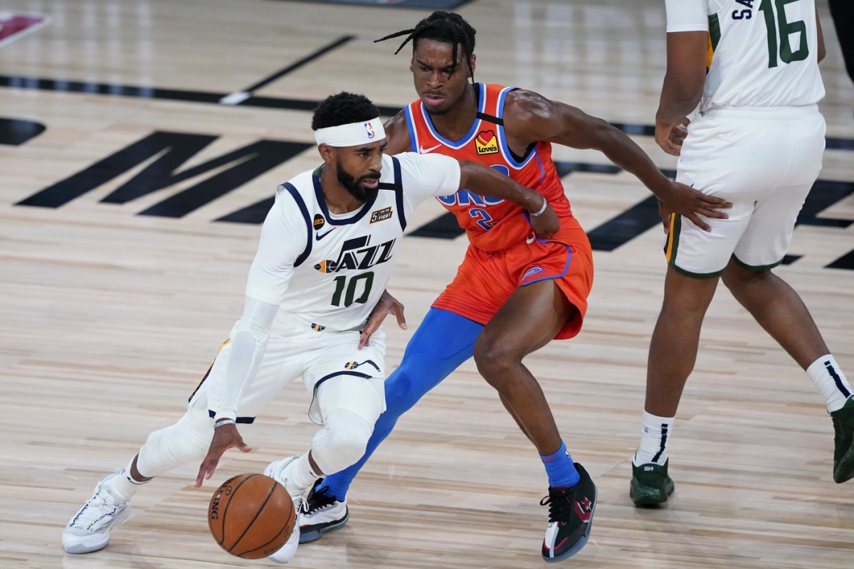 Mike Conley (10) drives through the lane against the Oklahoma City Thunder