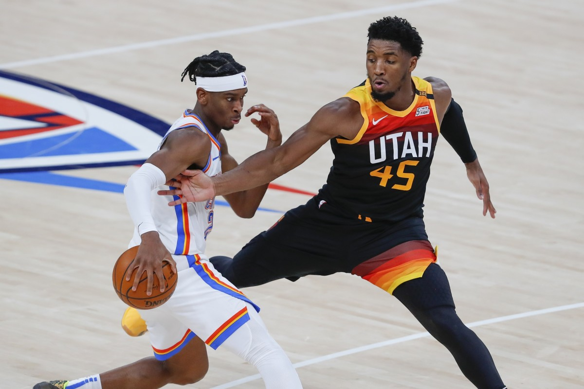 Donovan Mitchell (45) goes for a steal against the Oklahoma City Thunder