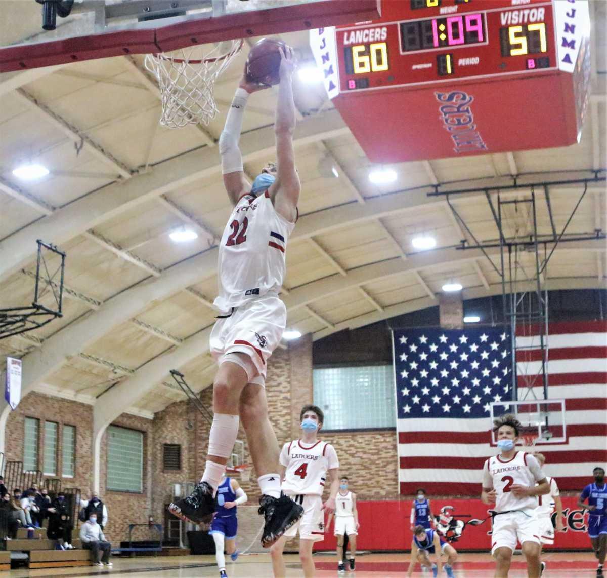 St. John's Northwestern Academies guard Brandin Podziemski throws down a dunk to seal a win over Oak Creek.
