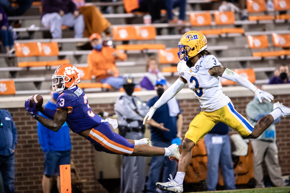 Clemson receiver Amari Rodgers (3) dives into the end zone defended by Pitt defensive back Damar Hamlin (3) for a touchdown. Mandatory Credit: Ken Ruinard-USA TODAY