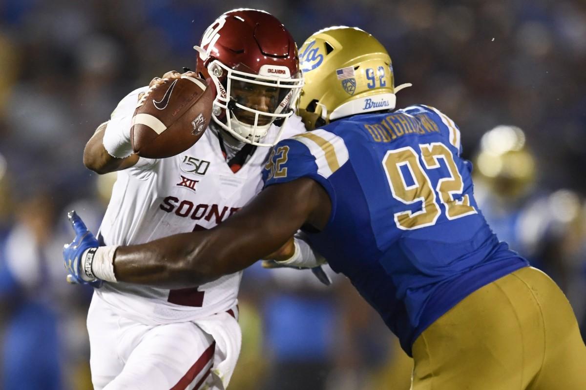 Oklahoma quarterback Jalen Hurts (1) moves the ball while UCLA defensive lineman Osa Odighizuwa (92) defends. Mandatory Credit: Kelvin Kuo-USA TODAY