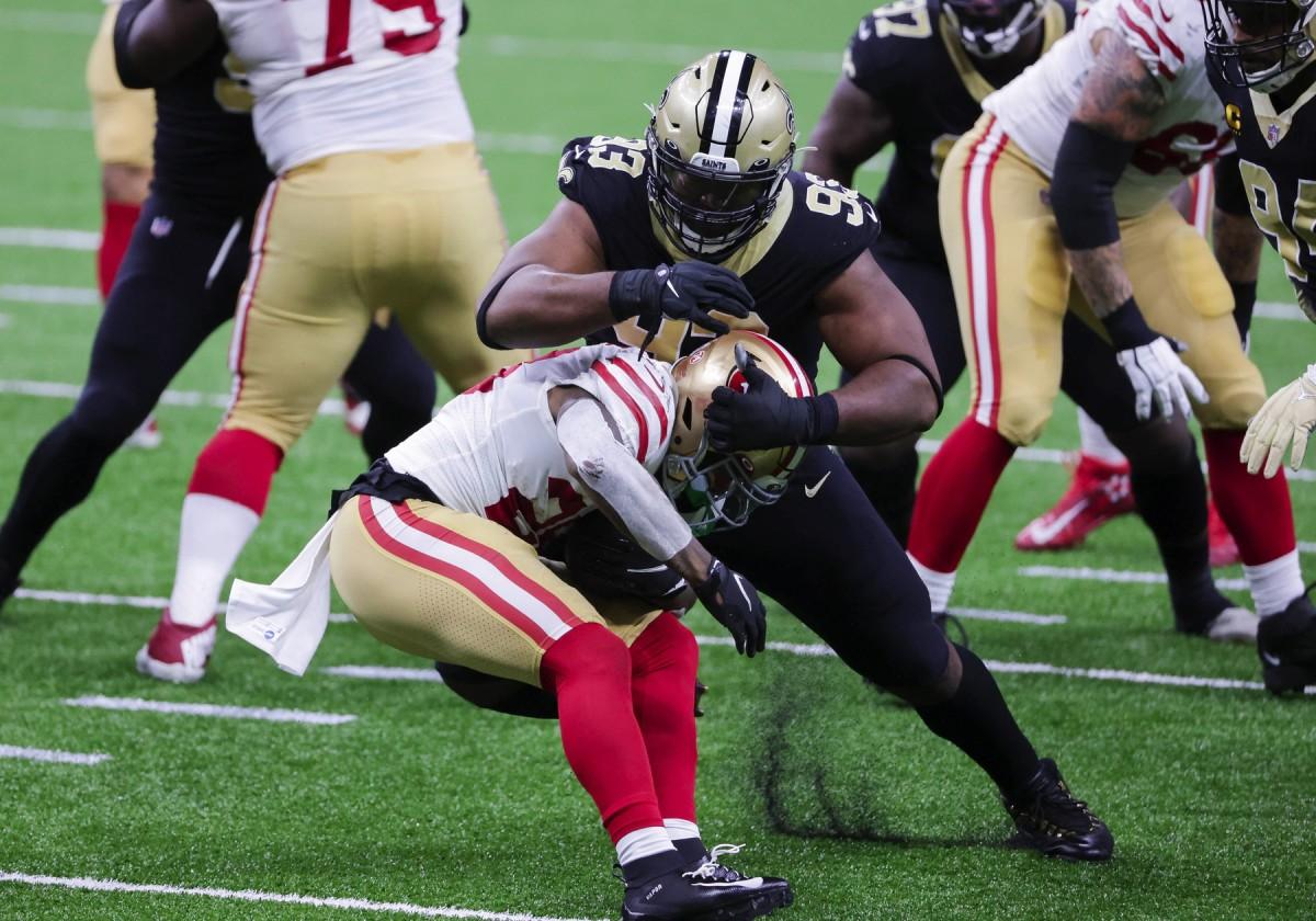 New Orleans Saints defensive tackle David Onyemata (93) stops 49ers running back Jerick McKinnon (28). Mandatory Credit: Derick E. Hingle-USA TODAY