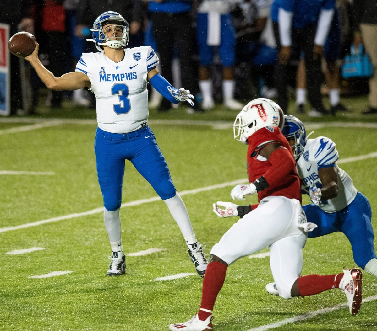 Memphis quarterback Brady White (3) throws a touchdown pass early against Florida Atlantic in the Montgomery Bowl held at Cramton Bowl in Montgomery, Ala., on Wednesday December 23, 2020.