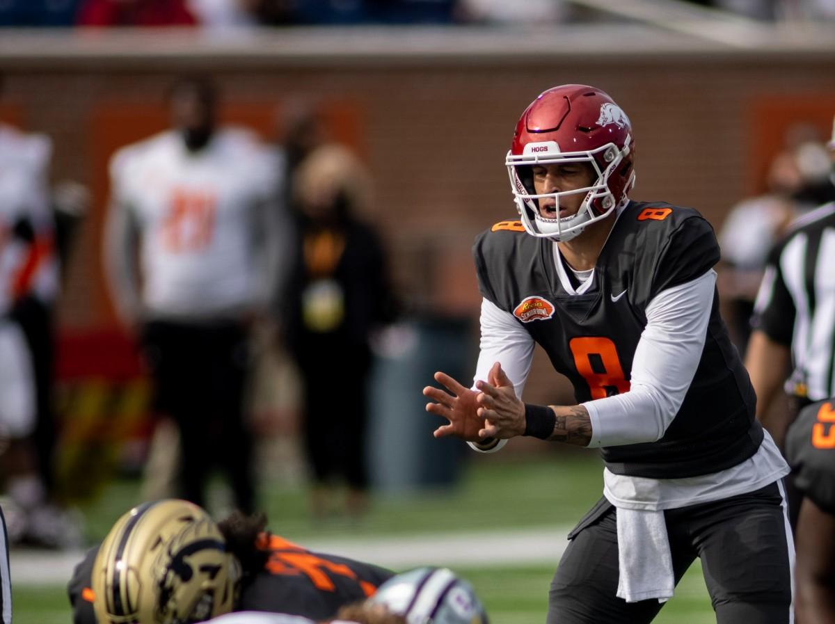 Jan 30, 2021; Mobile, AL, USA; National quarterback Feleipe Franks of Arkansas (8) runs a play in the first half of the 2021 Senior Bowl at Hancock Whitney Stadium.