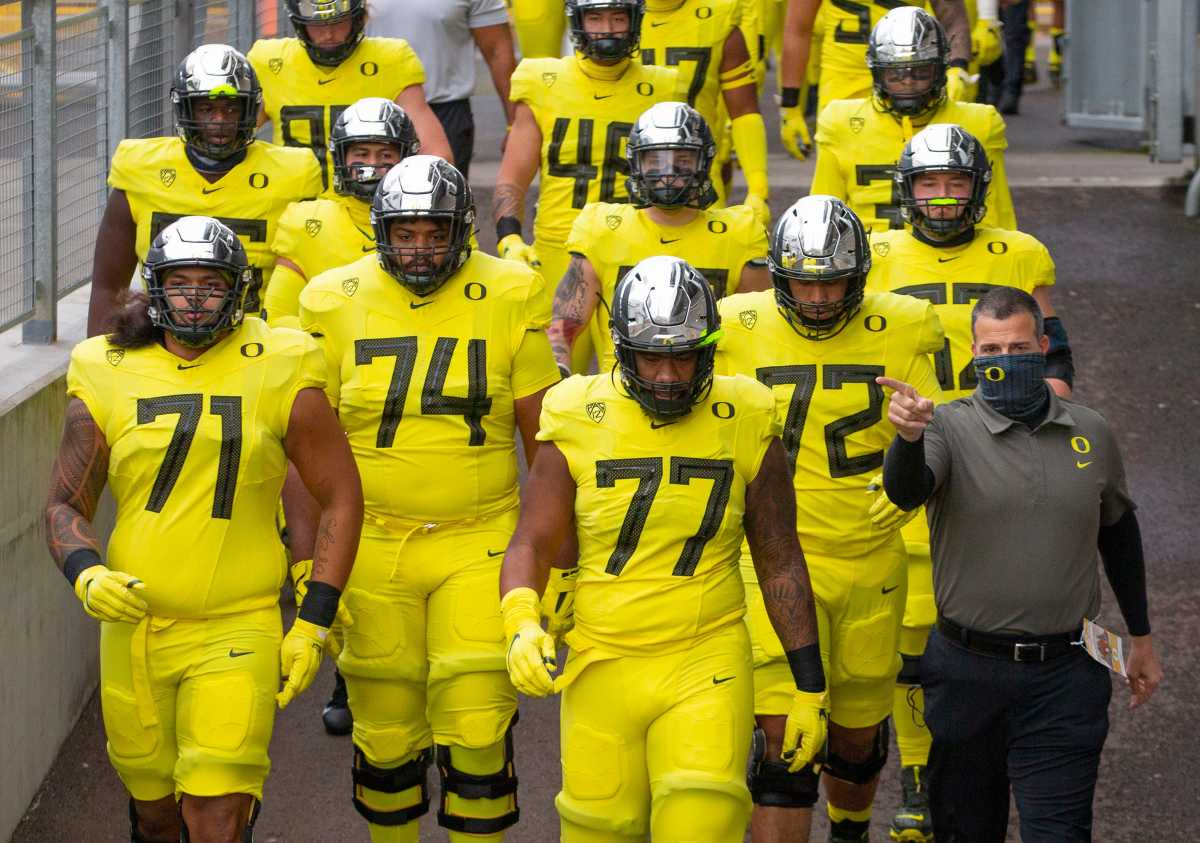 Mario Cristobal and the offensive line walking into battle against Oregon State.