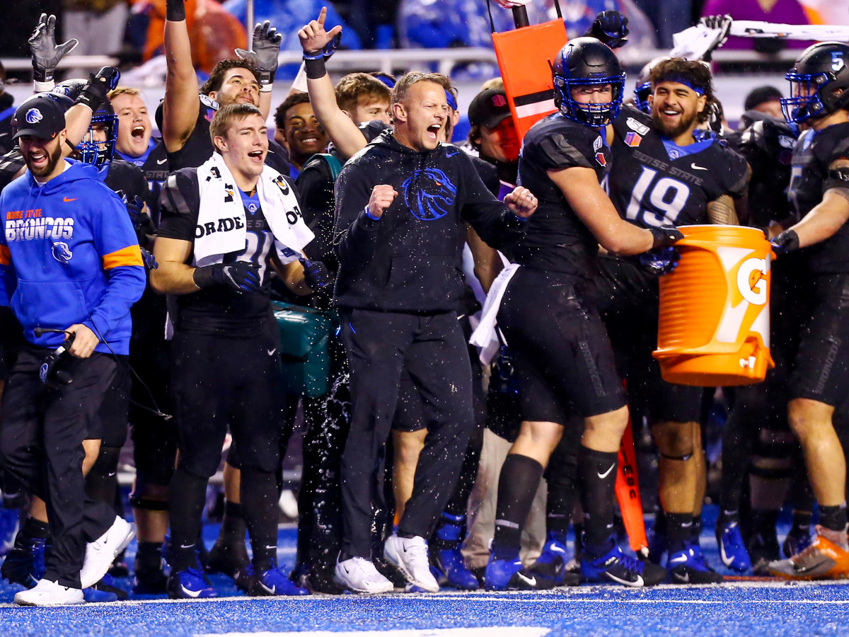 Dec 7, 2019; Boise, ID, USA; Boise State Broncos head coach Bryan Harsin celebrates with his team at the conclusion of the second half of the Mountain West Championship at Albertsons  Stadium versus Hawaii Warriors. Boise State defeats Hawaii 31-10.