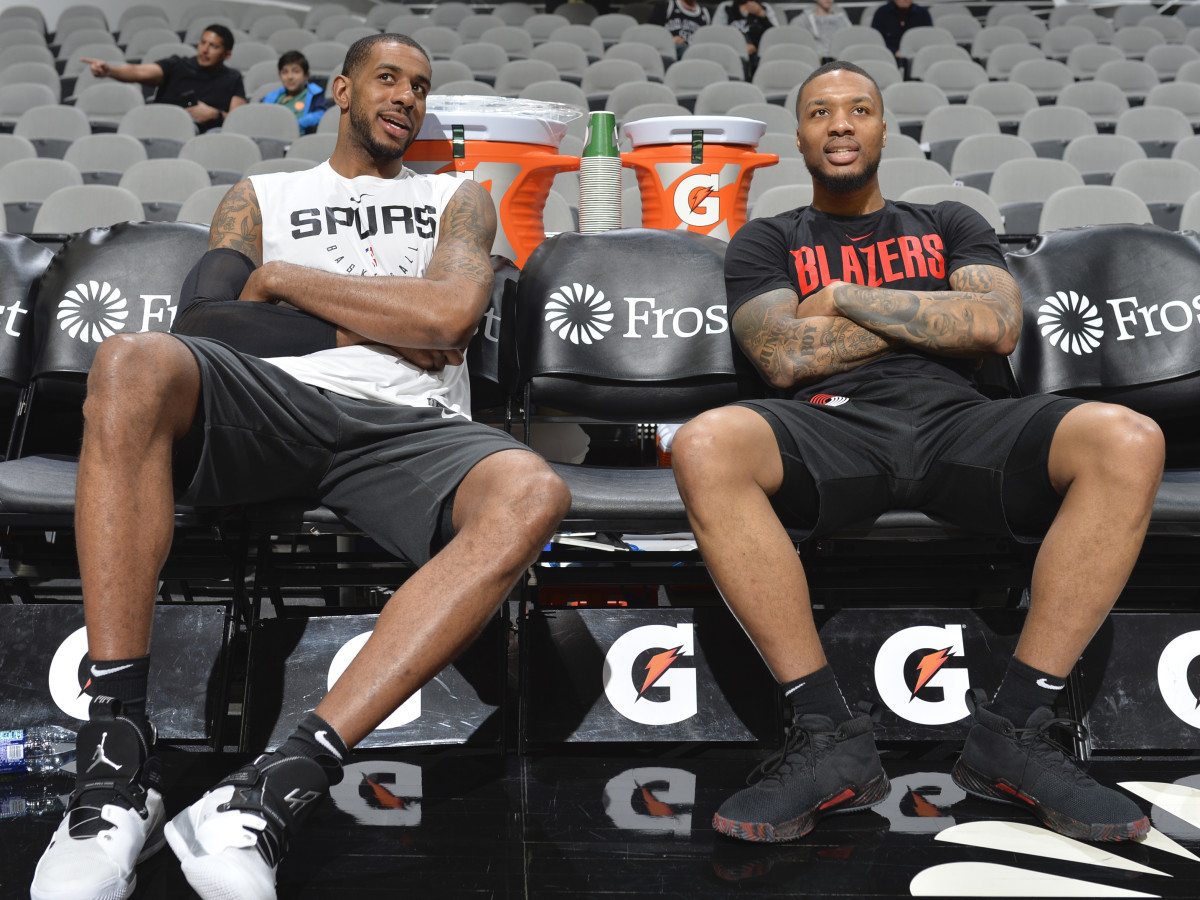 LaMarcus Aldridge #12 of the San Antonio Spurs and Damian Lillard #0 of the Portland Trail Blazers talks before the game on March 16, 2019 at the AT&T Center in San Antonio.