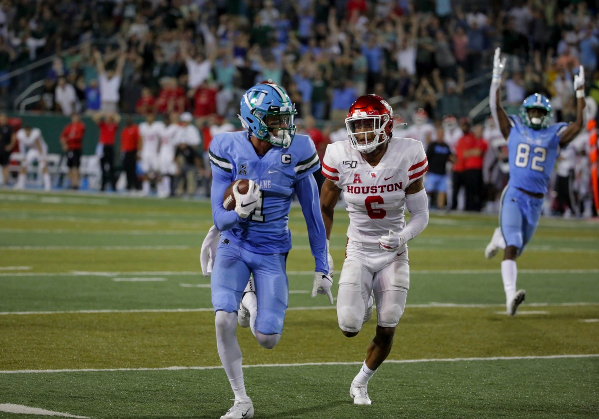 Sep 19, 2019; New Orleans, LA, USA; Tulane Green Wave wide receiver Jalen McCleskey (1) runs after a catch for a touchdown past Houston cornerback Damarion Williams (6). Mandatory Credit: Derick E. Hingle-USA TODAY