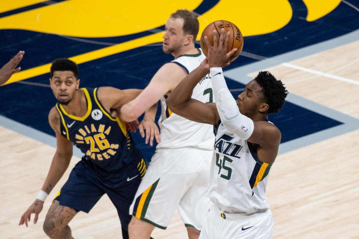 Donovan Mitchell (45) shoots a three pointer over the Indiana Pacers