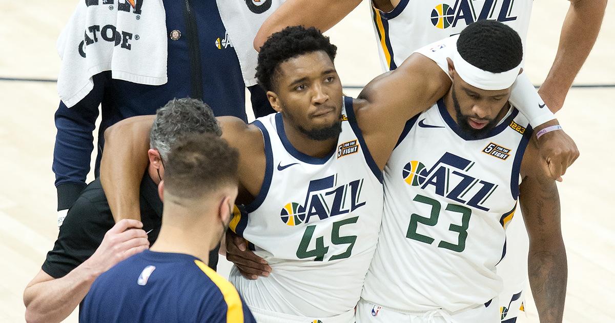 Utah Jazz guard Donovan Mitchell (45) is helped off the court after suffering an apparent injury during the second half against the Indiana Pacers at Vivint Smart Home Arena.