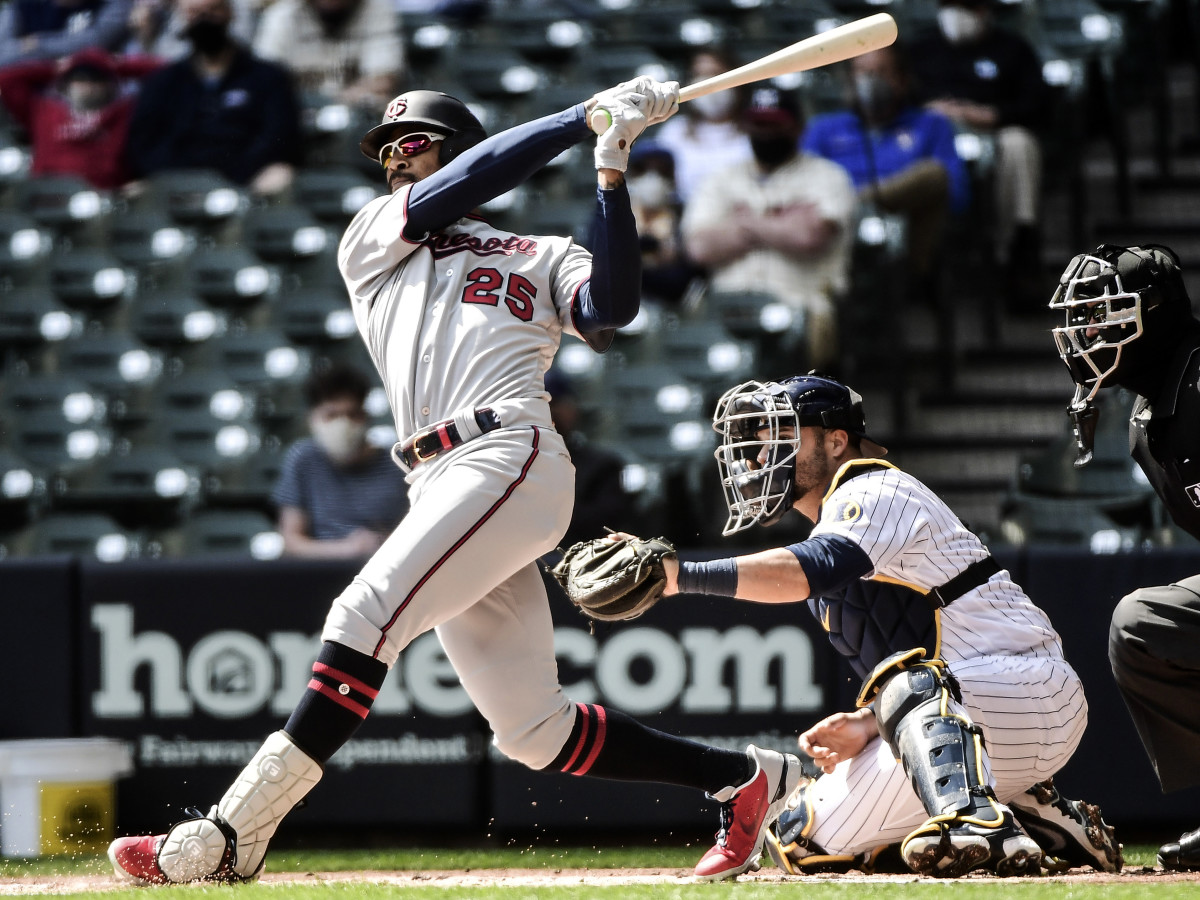 Apr 4, 2021; Milwaukee, Wisconsin, USA;  Minnesota Twins center fielder Byron Buxton (25) hits a double in the first inning as Milwaukee Brewers catcher Manny Pina (9) watches at American Family Field.