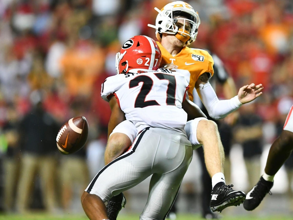 Tennessee quarterback Brian Maurer (18) fumbles the ball while sacked by Georgia defensive back Eric Stokes (27)© Saul Young/News Sentinel, Knoxville News Sentinel via Imagn Content Services, LLC