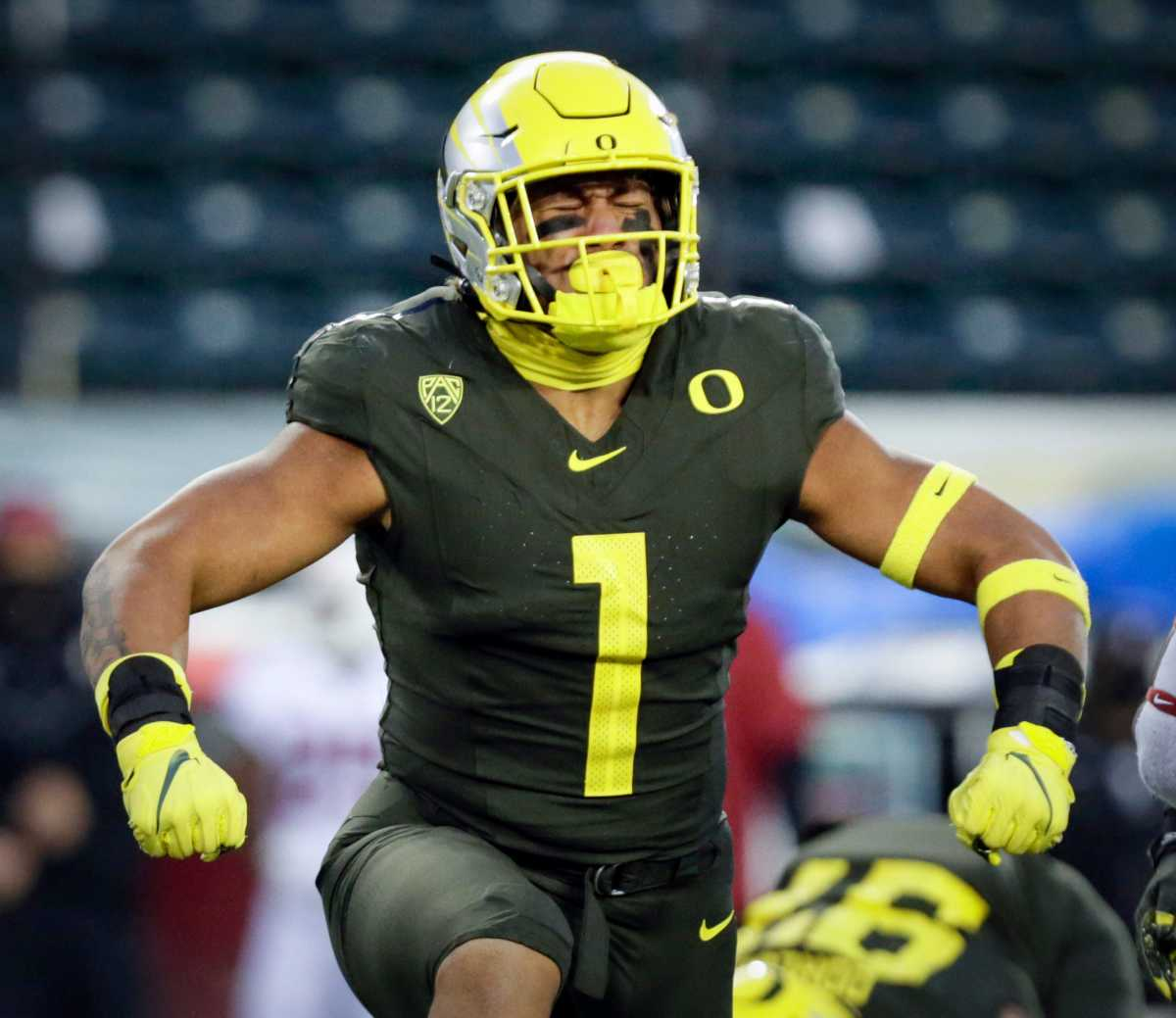 Noah Sewell flexes after making a big play against Stanford on November 7, 2020 in Autzen Stadium.