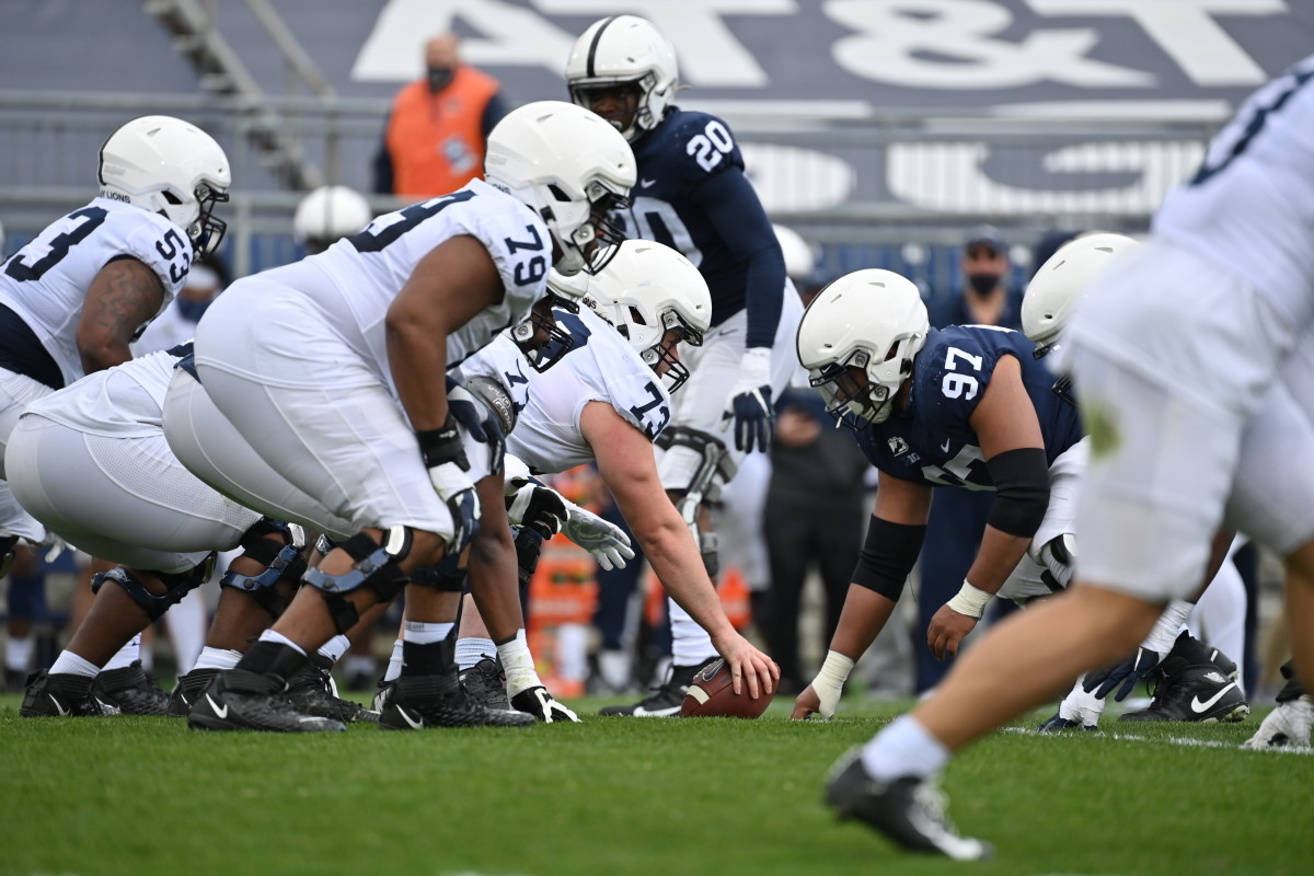 Scrimmage action, featuring center Mike Miranda (73) and tackles Rasheed Walker (53) and Caedan Wallace (79)