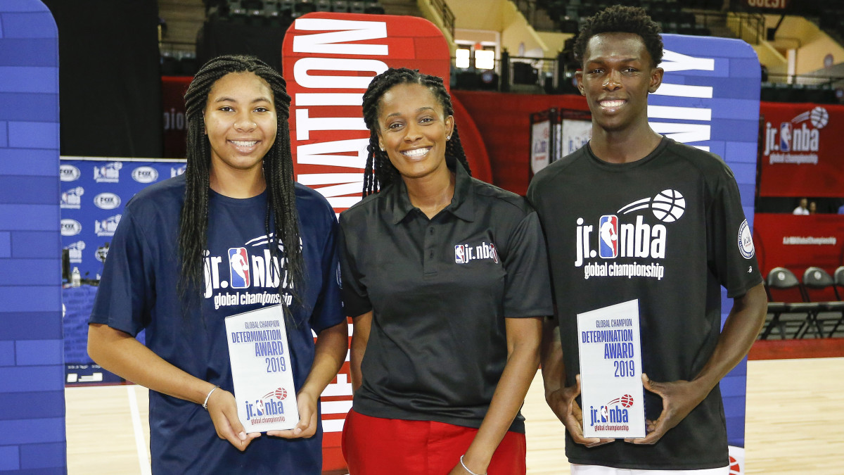 WNBA star Swin Cash poses with Determination Award winners Marouf Moumine (right) and Breya Cunningham (left) during the closing ceremonies of the Jr. NBA Championship Tournament at ESPN Wide World of...