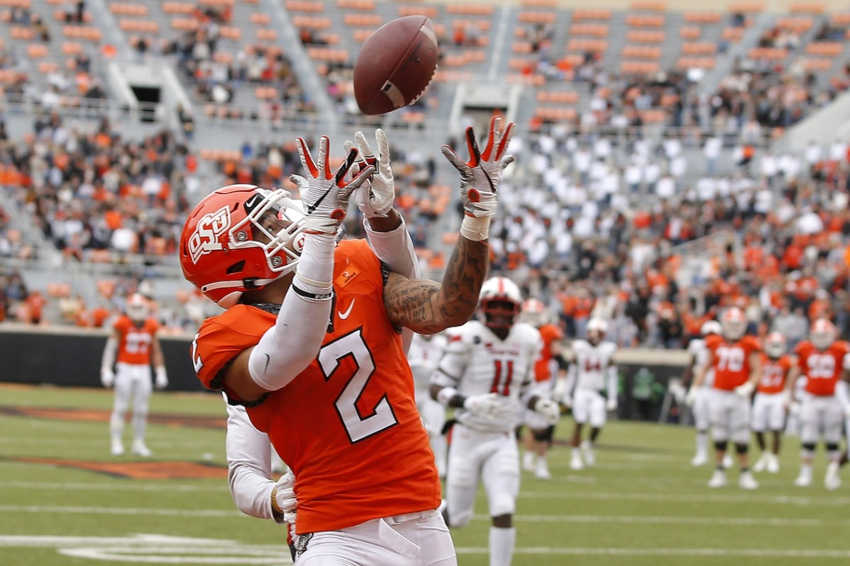 Oklahoma State Cowboys wide receiver Tylan Wallace (2) catches a touchdown pass against Texas Tech. Mandatory Credit: Bryan Terry-USA TODAY Sports