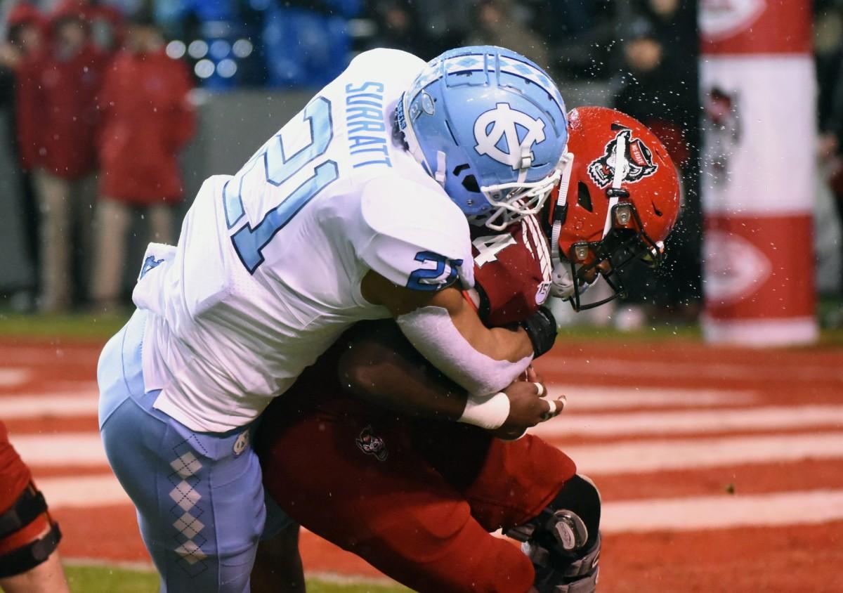 North Carolina State Wolfpack running back Zonovan Knight (24) is tackled by North Carolina linebacker Chazz Surratt (21). Mandatory Credit: Rob Kinnan-USA TODAY