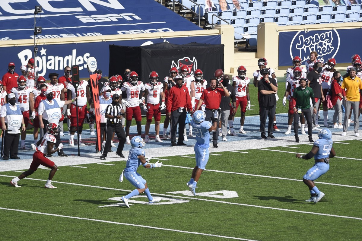 North Carolina Tar Heels linebacker Chazz Surratt (21) North Carolina State Wolfpack wide receiver Porter Rooks (14). Mandatory Credit: Bob Donnan-USA TODAY