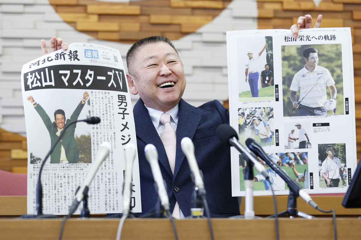 Yasuhiko Abe, Matsuyama's former coach from Tohoku Fukushi University, held up special editions of newspapers at a press conference in northeastern Japan on the day of his former pupil's Masters win.