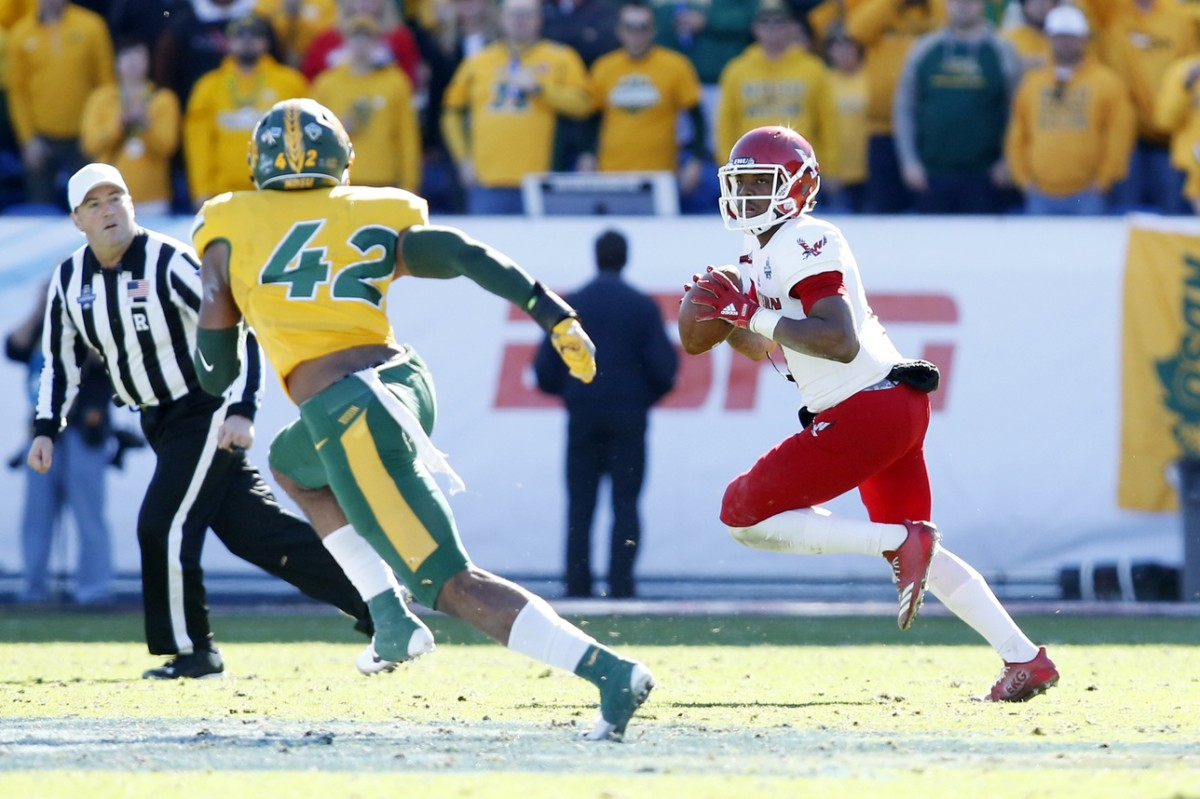 Eastern Washington quarterback Eric Barriere (3) looks to pass against North Dakota State Bison linebacker Jabril Cox (42) in the Division I Football Championship. Mandatory Credit: Tim Heitman-USA TODAY Sports
