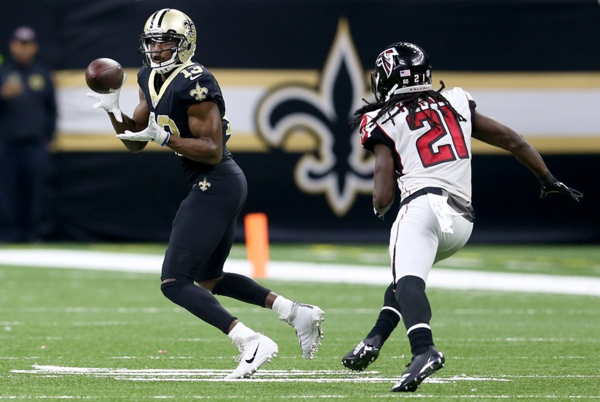 New Orleans Saints wide receiver Michael Thomas (13) makes a catch while defended by Falcons cornerback Desmond Trufant (21). Mandatory Credit: Chuck Cook-USA TODAY