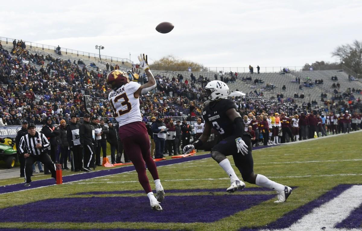 Minnesota Golden Gophers wide receiver Rashod Bateman (13) catches a touchdown as Northwestern defensive back Trae Williams (3) defends. Mandatory Credit: David Banks-USA TODAY