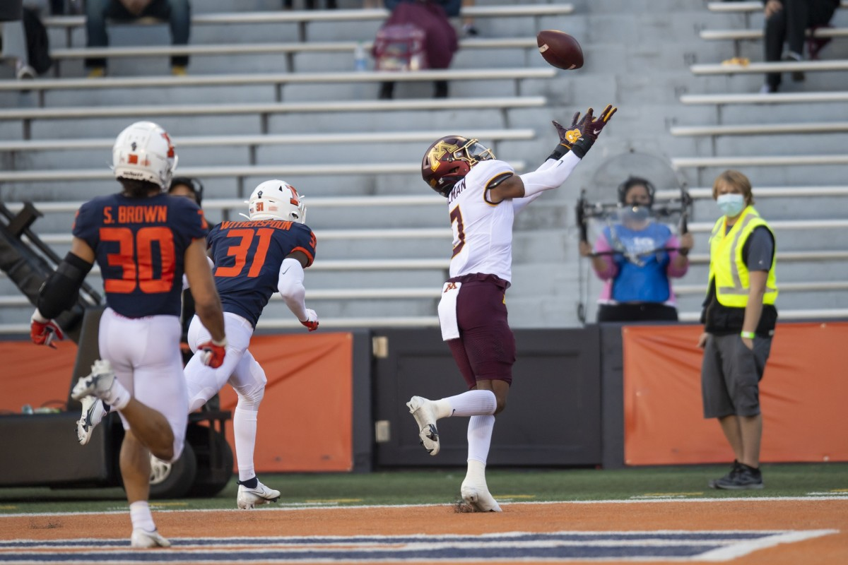 Minnesota Golden Gophers wide receiver Rashod Bateman (0) catches a touchdown pass against Illinois. Mandatory Credit: Patrick Gorski-USA TODAY Sports