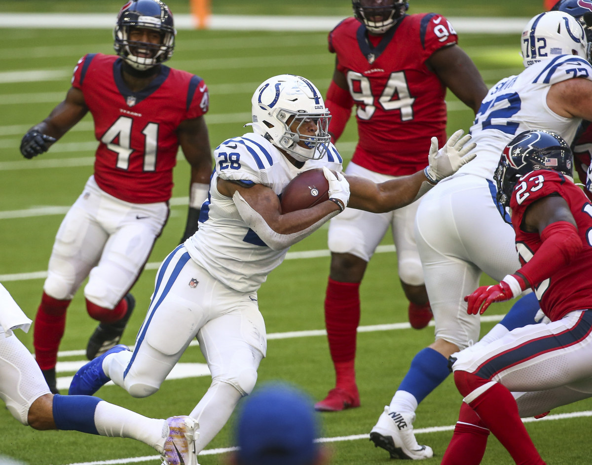 Dec 6, 2020; Houston, Texas, USA; Indianapolis Colts running back Jonathan Taylor (28) runs with the ball during the fourth quarter against the Houston Texans at NRG Stadium. Mandatory Credit: Troy Taormina-USA TODAY Sports