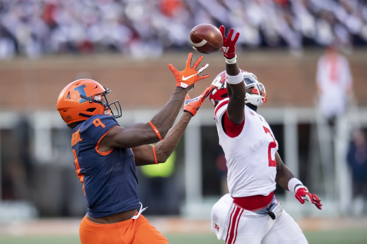 Illinois Fighting Illini wide receiver Josh Imatorbhebhe (9) catches a pass for a touchdown against Rutgers. Mandatory Credit: Patrick Gorski-USA TODAY Sports