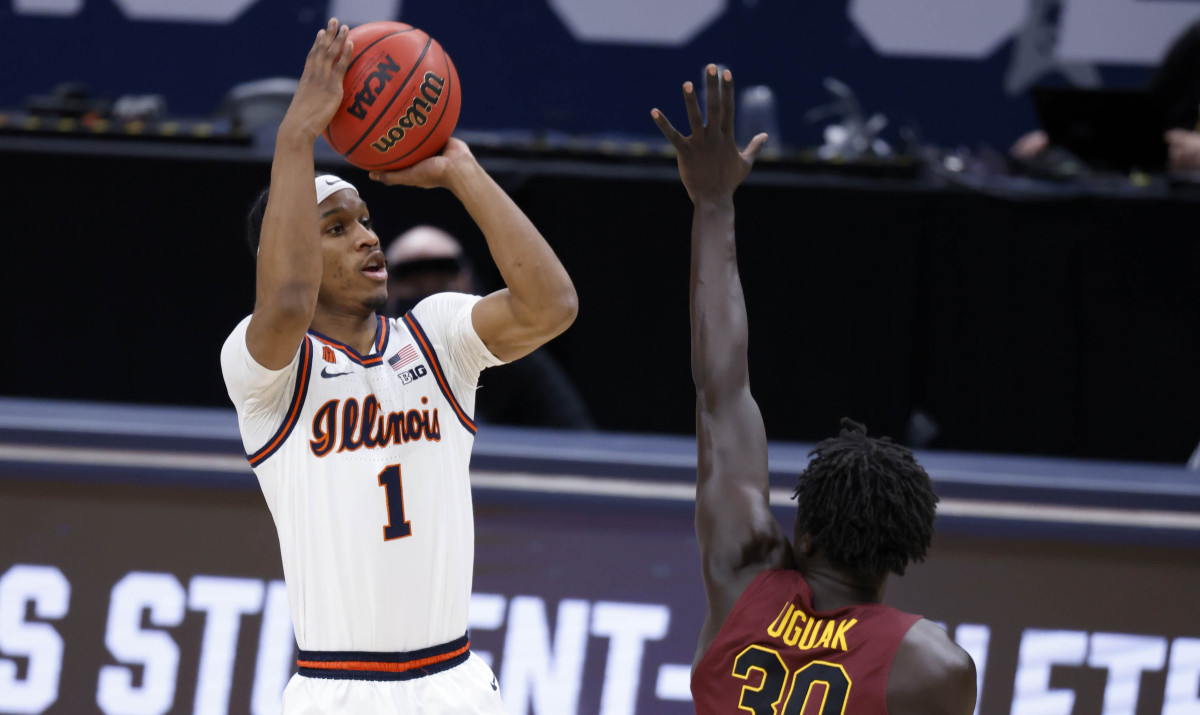 Illinois Fighting Illini guard Trent Frazier (1) takes a shot as Loyola (Il) Ramblers forward Aher Uguak (30) attempts a block during the second round of the 2021 NCAA Tournament on Sunday, March 21, 2021, at Bankers Life Fieldhouse in Indianapolis, Ind.