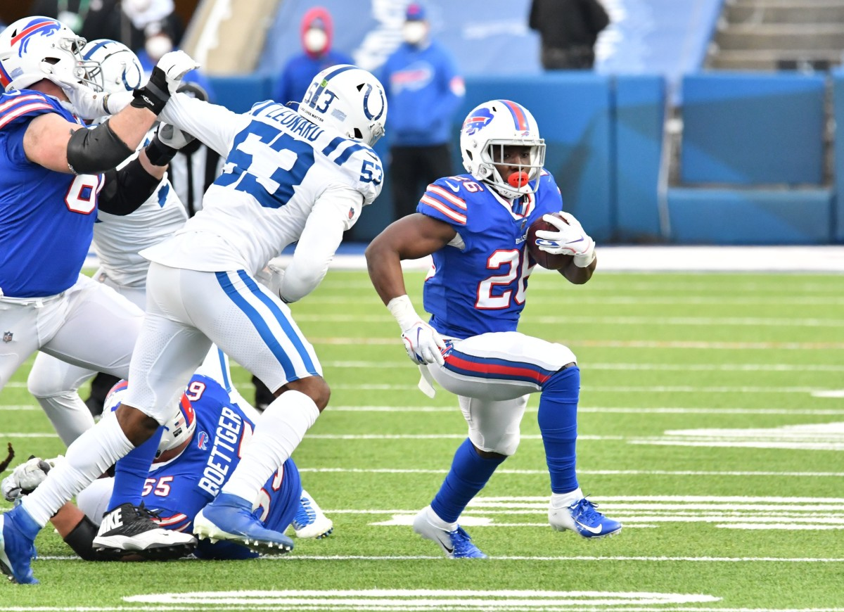 Buffalo Bills running back Zack Moss (20) gets past Indianapolis Colts outside linebacker Darius Leonard (53) to pick up a first down in the fourth quarter at Bills Stadium.