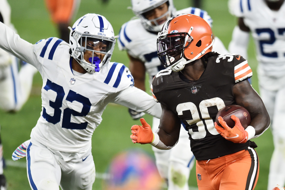 Oct 11, 2020; Cleveland, Ohio, USA; Cleveland Browns running back D'Ernest Johnson (30) runs with the ball as Indianapolis Colts free safety Julian Blackmon (32) defends during the second half at FirstEnergy Stadium. Mandatory Credit: Ken Blaze-USA TODAY Sports
