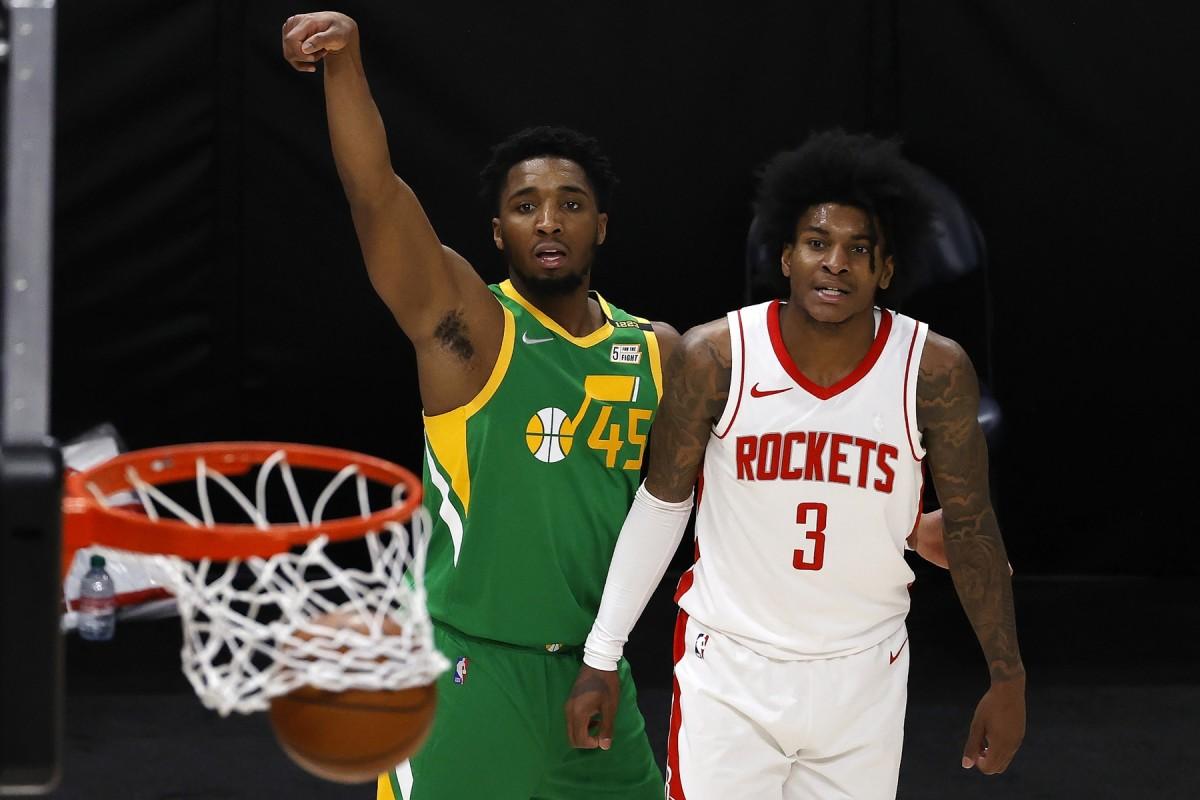 Donovan Mitchell (45) drills a three pointer against the Houston Rockets
