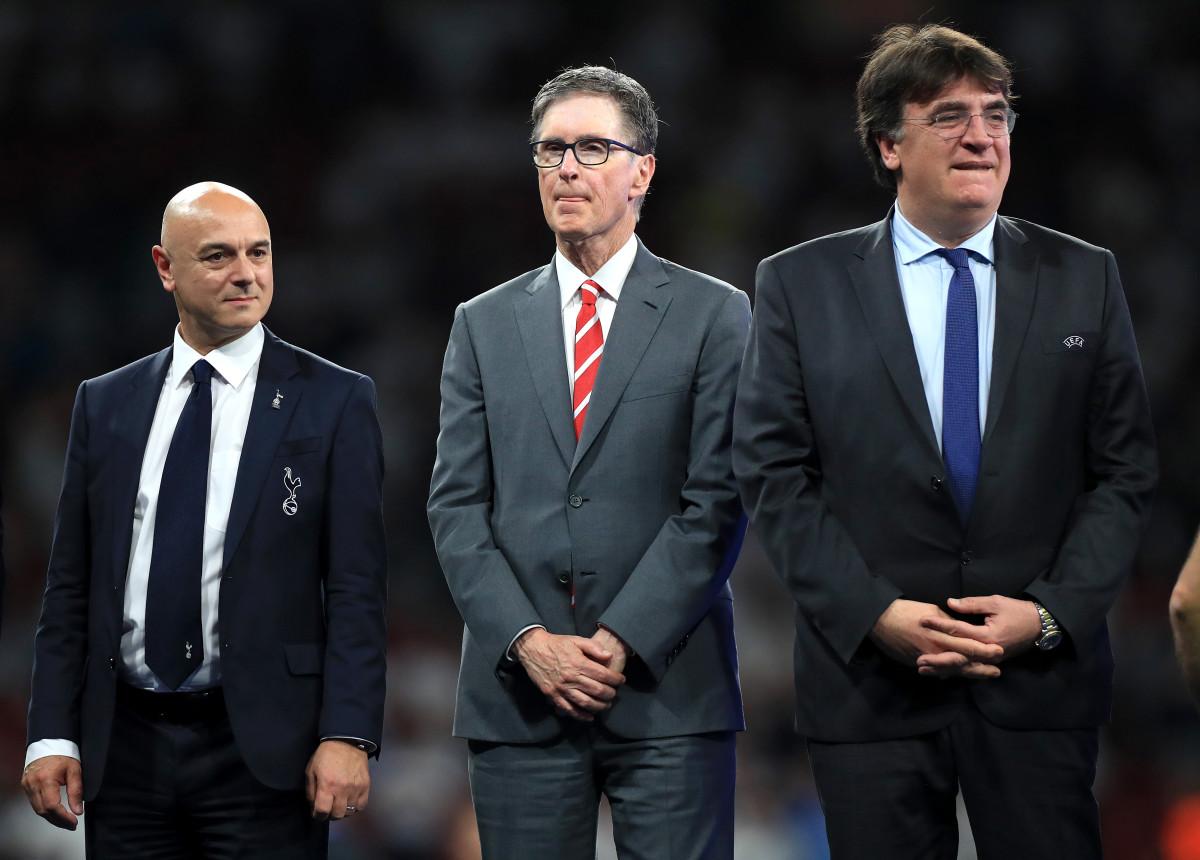 Tottenham Hotspur chairman Daniel Levy (left), Liverpool owner John W. Henry (center) and UEFA General Secretary Theodore Theodoridis.
