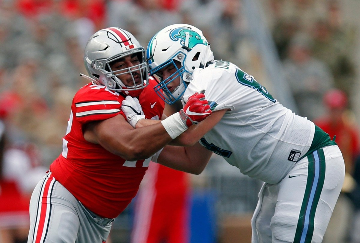 Ohio State Buckeyes defensive tackle Tommy Togiai (72) gets by Tulane lineman Corey Dublin (64)Eric Albrecht/Columbus Dispatch via Imagn Content Services, LLC