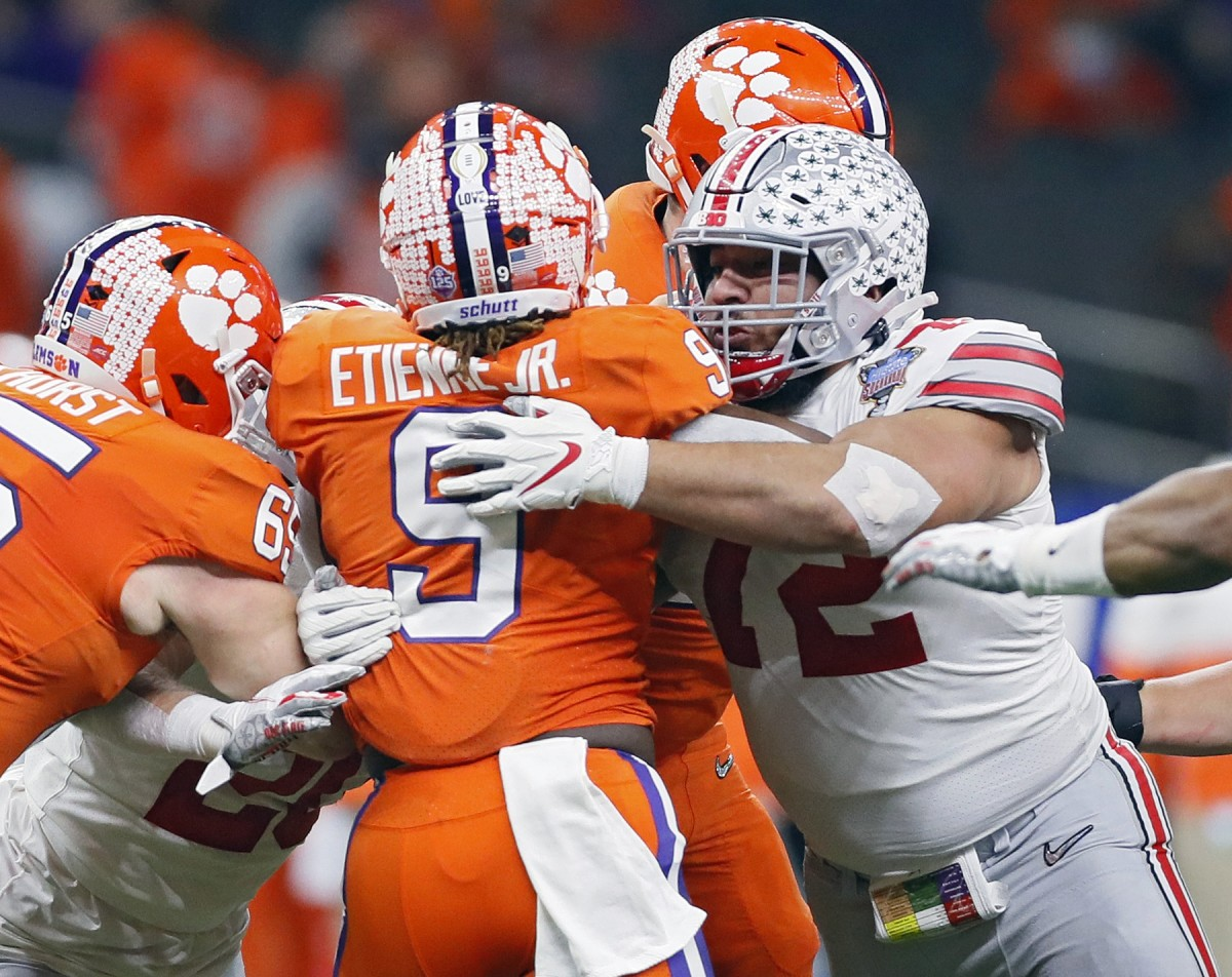 Ohio State Buckeyes defensive tackle Tommy Togiai (72) tackles Clemson running back Travis Etienne (9) during the College Football Playoff semifinal. Mandatory Credit: Ken Ruinard-USA TODAY