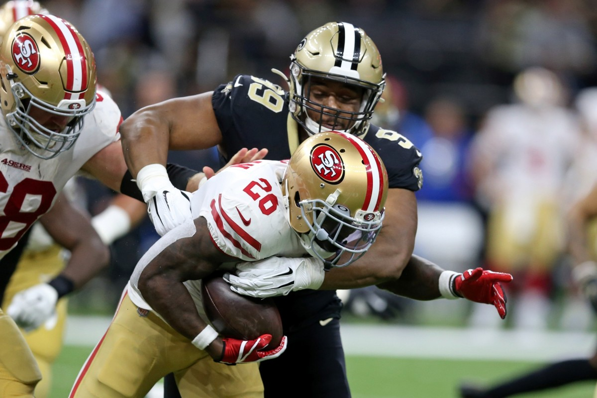 49ers running back Tevin Coleman (26) is tackled by New Orleans Saints defensive tackle Shy Tuttle (99). Mandatory Credit: Chuck Cook-USA TODAY Sports