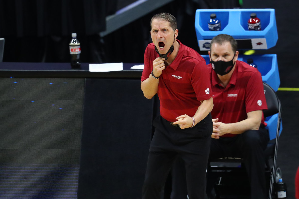 Arkansas Razorbacks head coach Eric Musselman yells from the sidelines against the Baylor Bears during the first half in the Elite Eight of the 2021 NCAA Tournament at Lucas Oil Stadium.