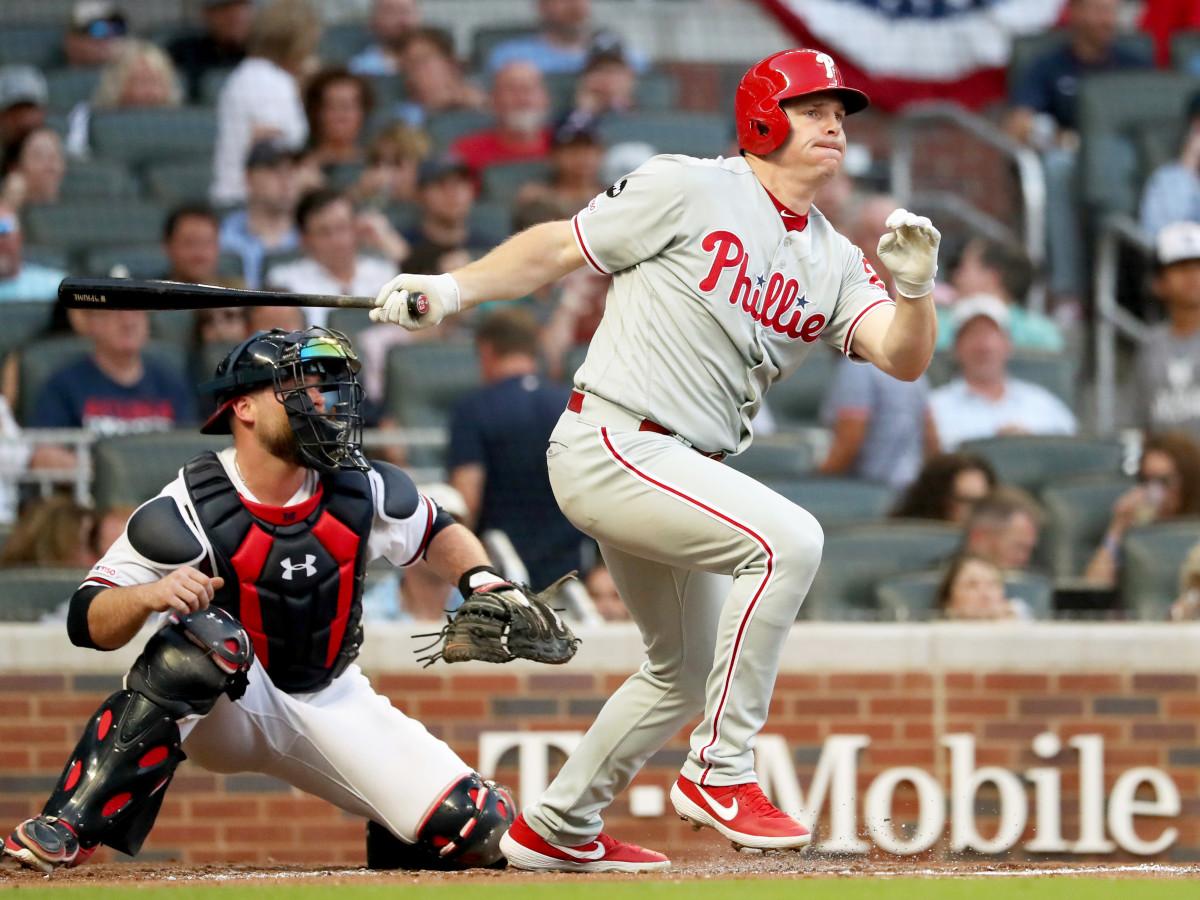 Jul 2, 2019; Atlanta, GA, USA; Philadelphia Phillies right fielder Jay Bruce (23) hits a two RBI double as Atlanta Braves catcher Brian McCann (16) looks on during the fourth inning at SunTrust Park.