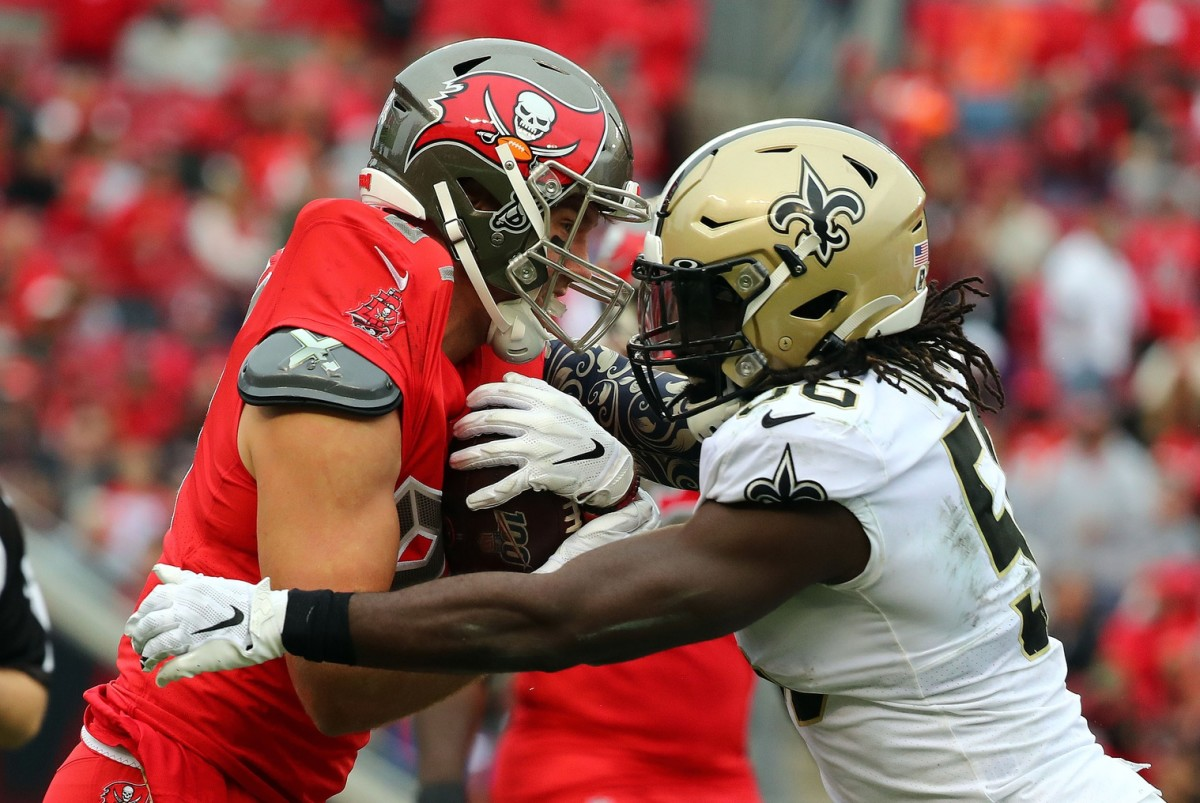 New Orleans linebacker Demario Davis (56) tackles Buccaneers tight end Cameron Brate (84). Mandatory Credit: Kim Klement-USA TODAY