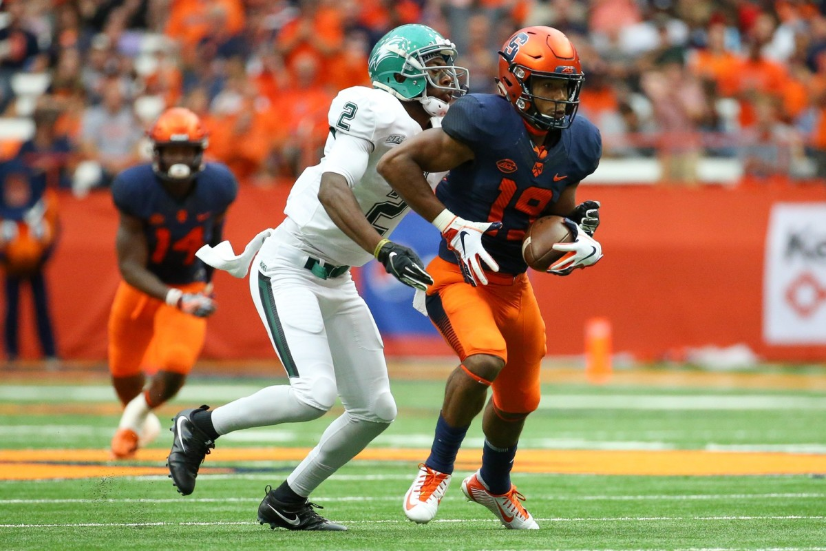 Syracuse defensive back Andre Cisco (19) intercepts a pass in front of Wagner receiver D'Erren Wilson (2) at the Carrier Dome. Mandatory Credit: Rich Barnes-USA TODAY