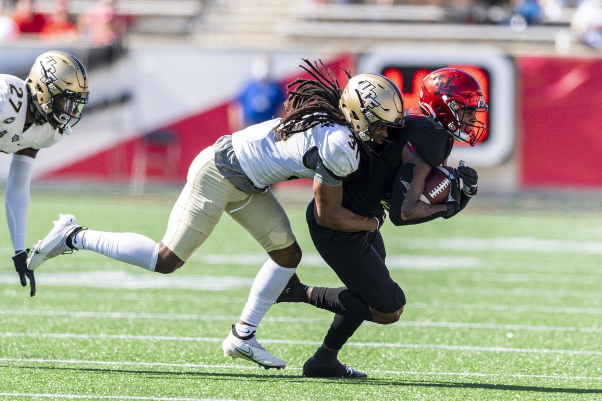Houston Cougars receiver Keith Corbin (2) is tackled by UCF Knights defensive back Aaron Robinson (31). Mandatory Credit: Maria Lysaker-USA TODAY Sports