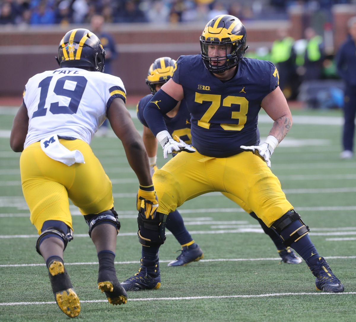Michigan offensive lineman Jalen Mayfield blocks defensive end Kwity Paye during the spring game Saturday, April 13, 2019 at Michigan Stadium in Ann Arbor. © Kirthmon F. Dozier, Detroit Free Press