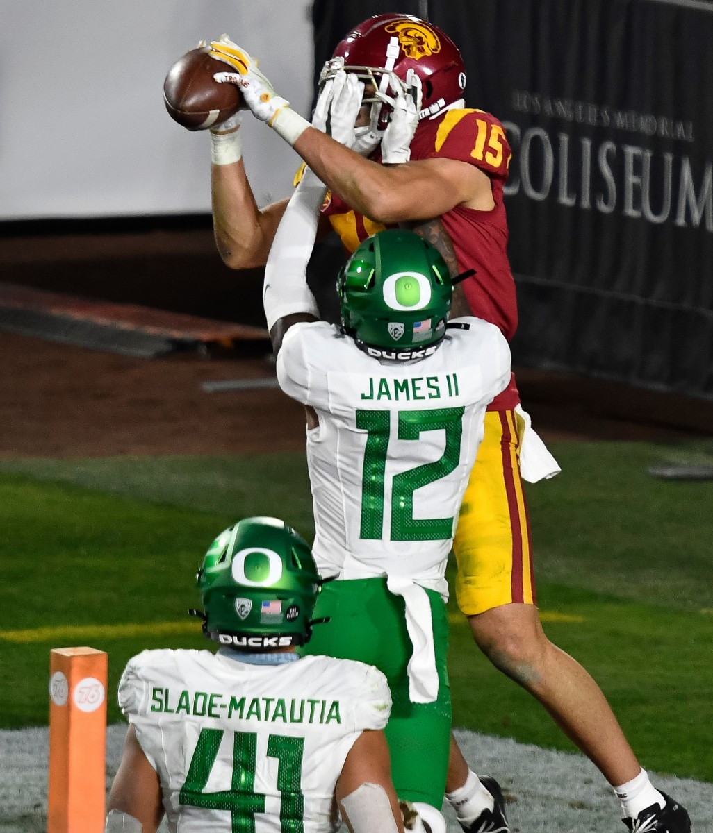 DJ James (12) breaks up a pass intended for wide receiver Drake London (15) against the USC Trojans in the 2020 Pac-12 Championship Game.