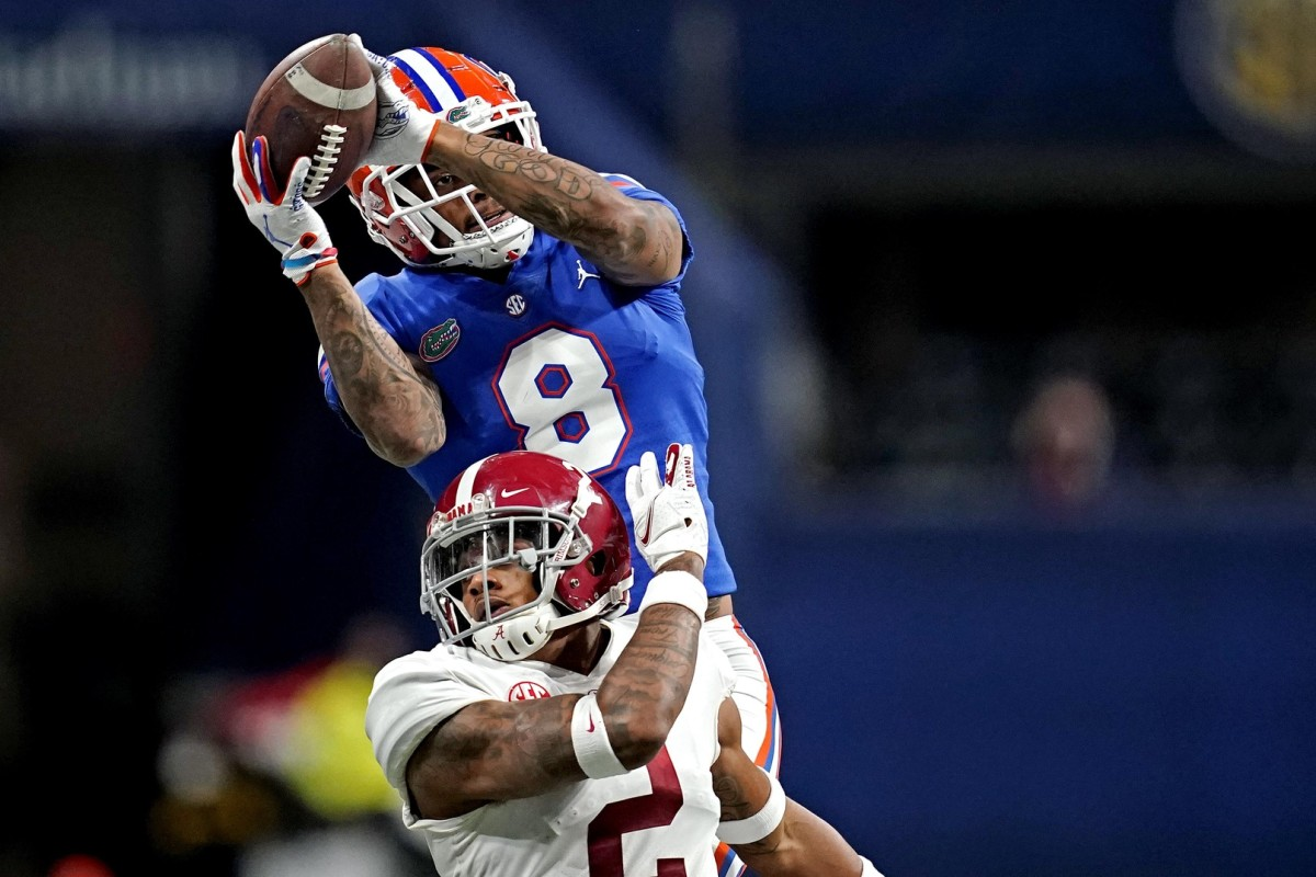 Florida Gators wide receiver Trevon Grimes (8) catches a touchdown against Alabama back Keilan Robinson (2) during the SEC Championship. Mandatory Credit: Dale Zanine-USA TODAY