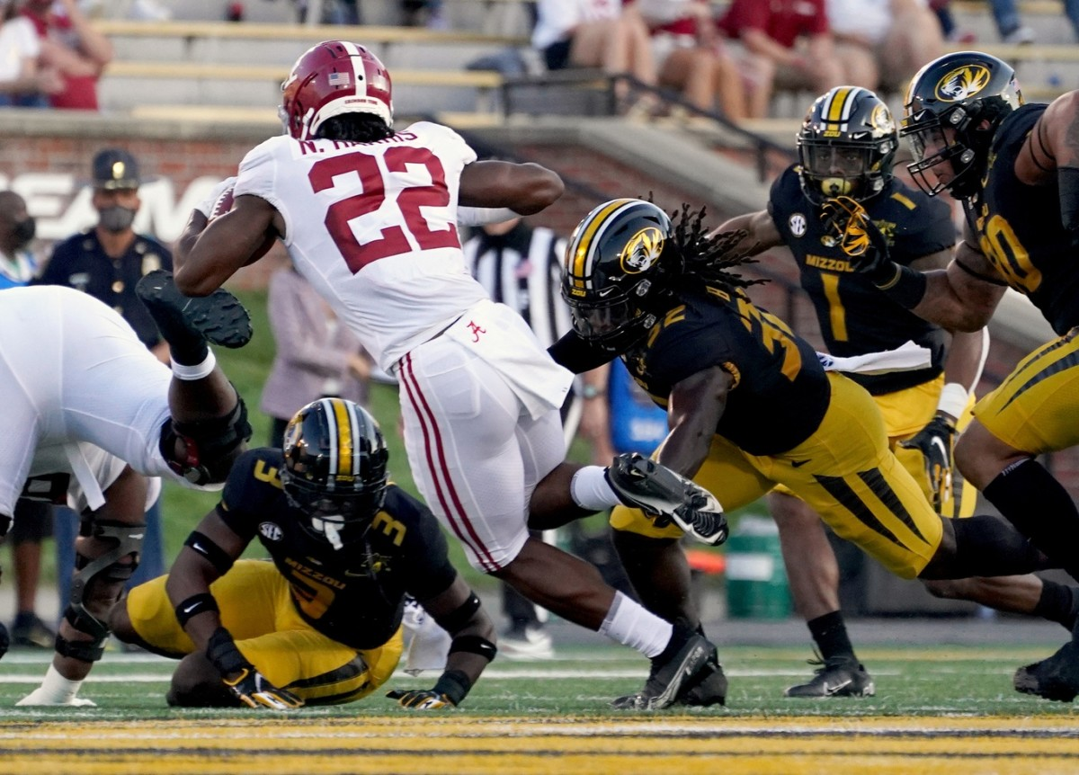 Alabama running back Najee Harris (22) is tackled by Missouri Tigers linebacker Nick Bolton (32). Mandatory Credit: Denny Medley-USA TODAY