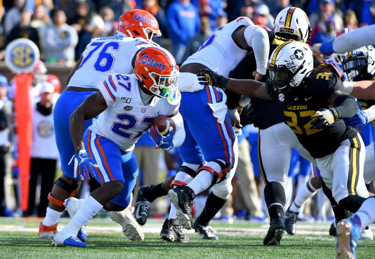 Florida Gators running back Dameon Pierce (27) runs the ball as Missouri Tigers linebacker Nick Bolton (32) defends. Mandatory Credit: Denny Medley-USA TODAY