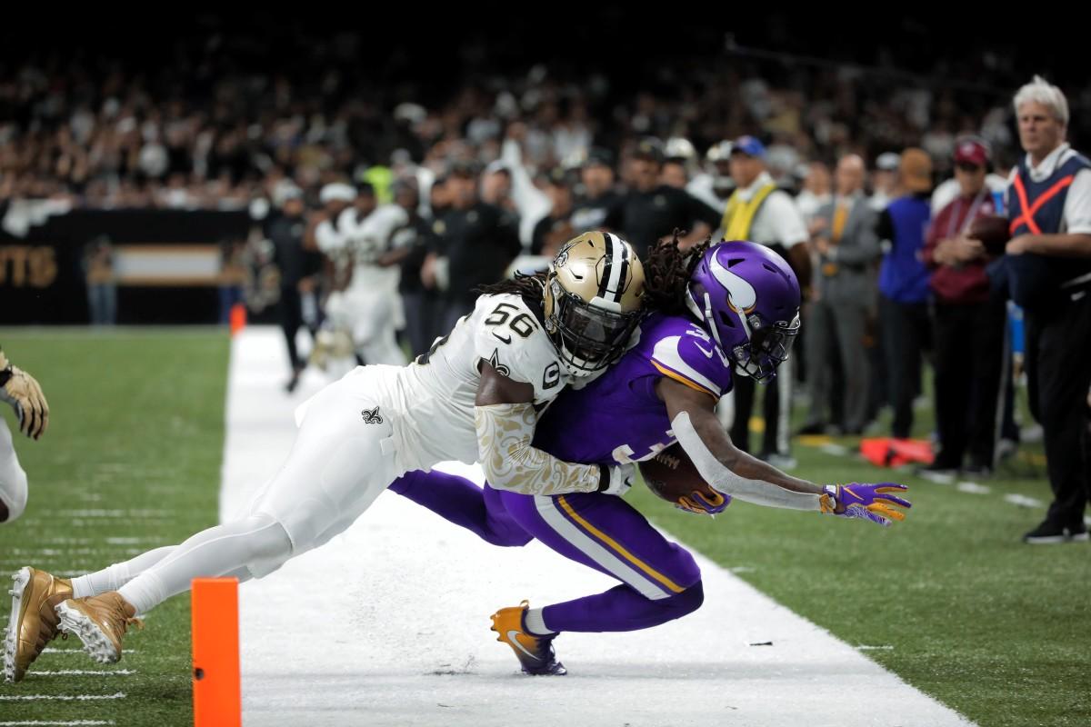 New Orleans Saints linebacker Demario Davis (56) tackles Vikings running back Dalvin Cook (33). Mandatory Credit: Derick Hingle-USA TODAY Sports