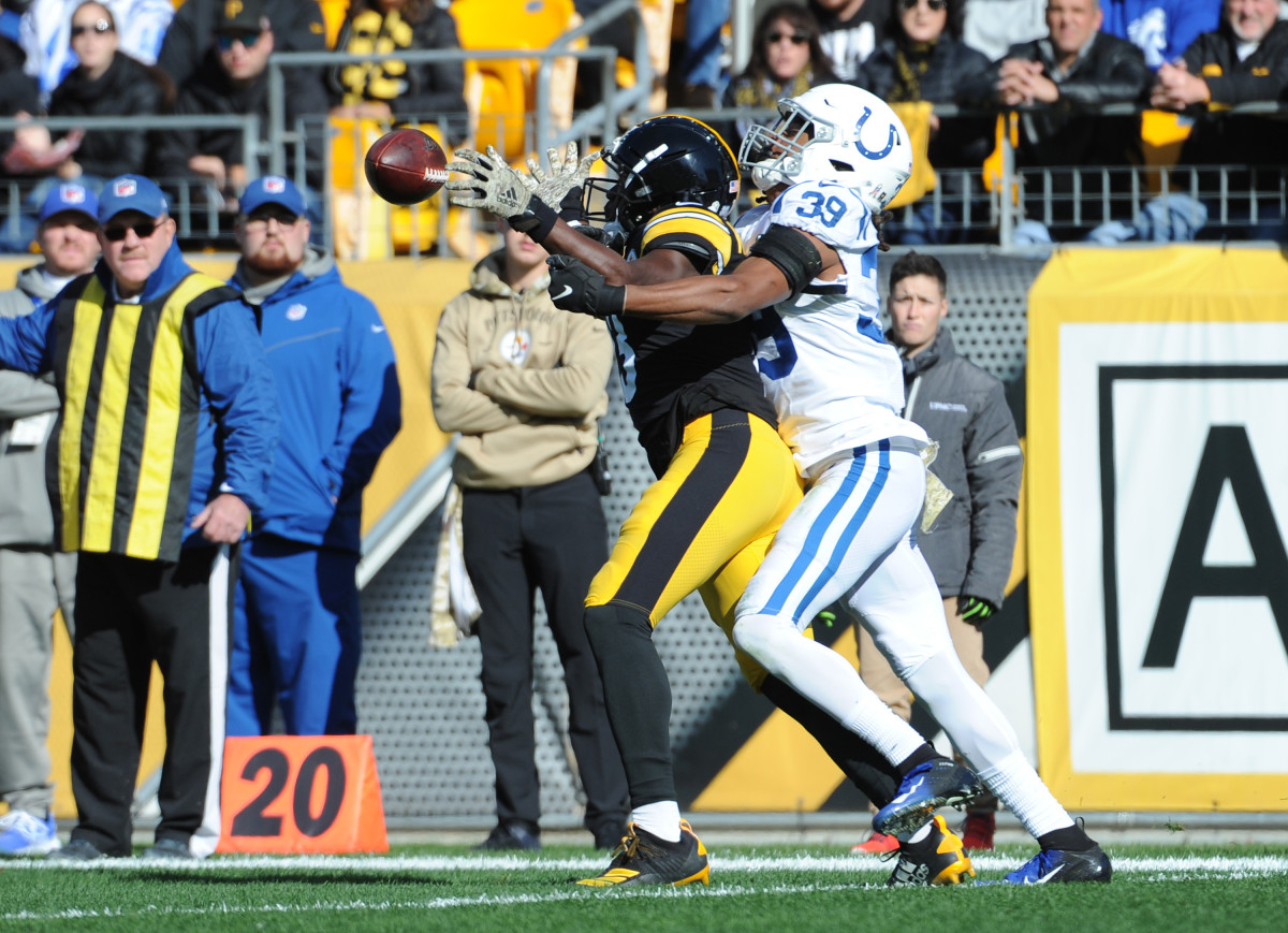 Nov 3, 2019; Pittsburgh, PA, USA; Pittsburgh Steelerswide receiver James Washington (13) catches a pass as Indianapolis Colts cornerback Marvell Tell II (39) applies coverage during the first quarter at Heinz Field.