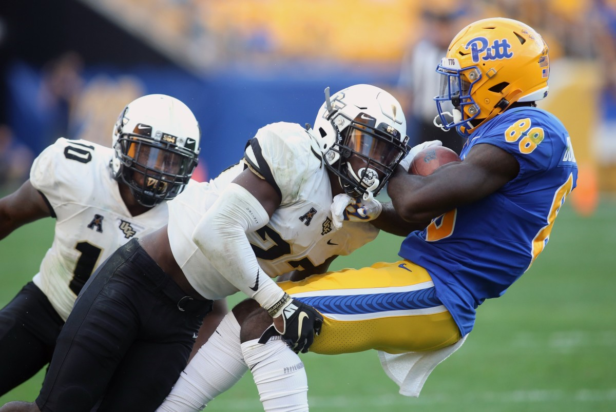 UCF defensive back Richie Grant (27) tackles Pitt Panthers receiver Dontavius Butler-Jenkins (88). Mandatory Credit: Charles LeClaire-USA TODAY